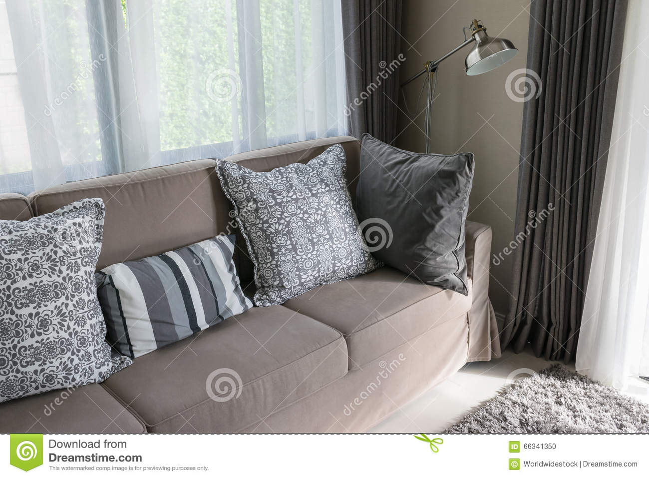 Brown Sofa With Grey Patterned Pillows Stock Photo Image Of Comfort Relax 66341350