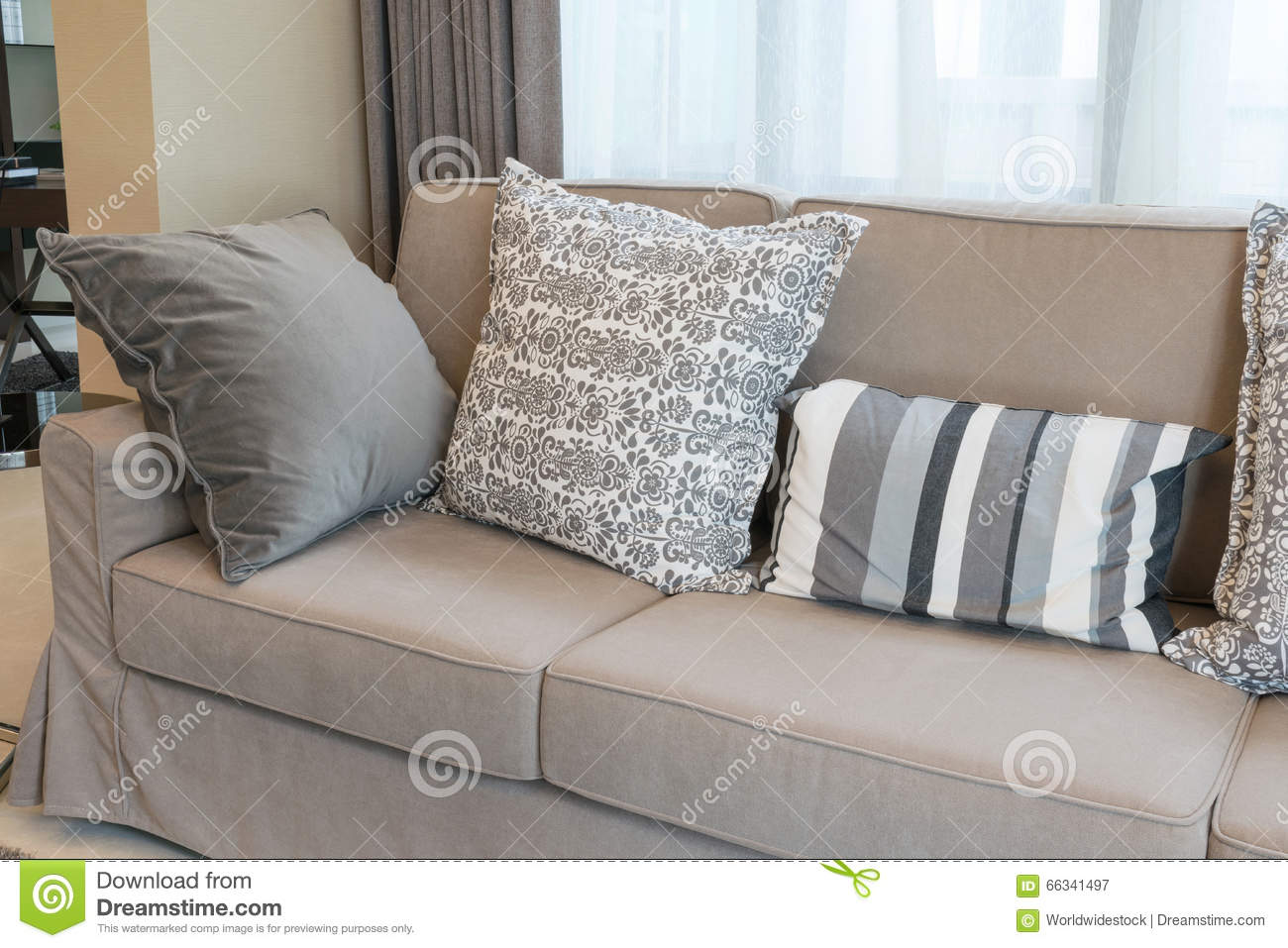 Brown Sofa With Grey Patterned Pillows Stock Photo - Image: 66341350