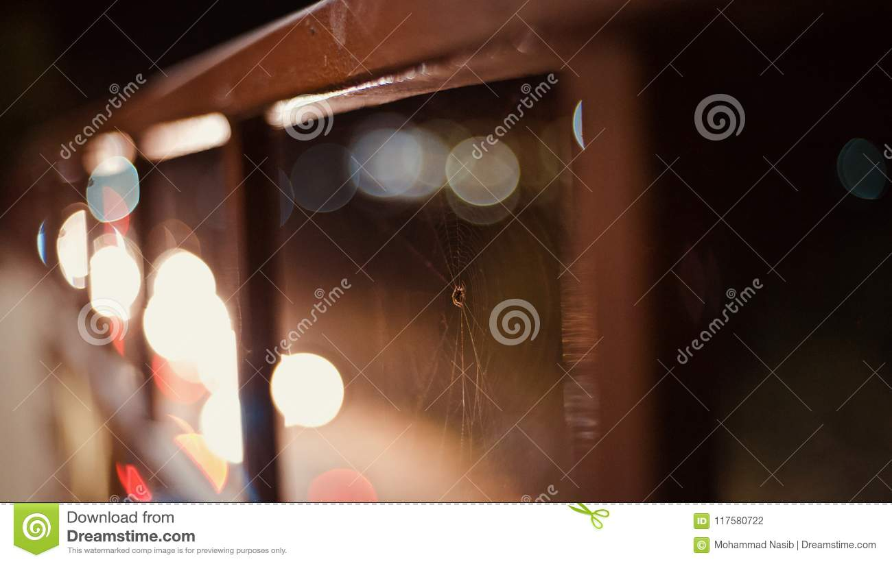 Download A Brown Spider Web With Illuminated Lights Photo Stock Photo - Image of photo, corridor: 117580722