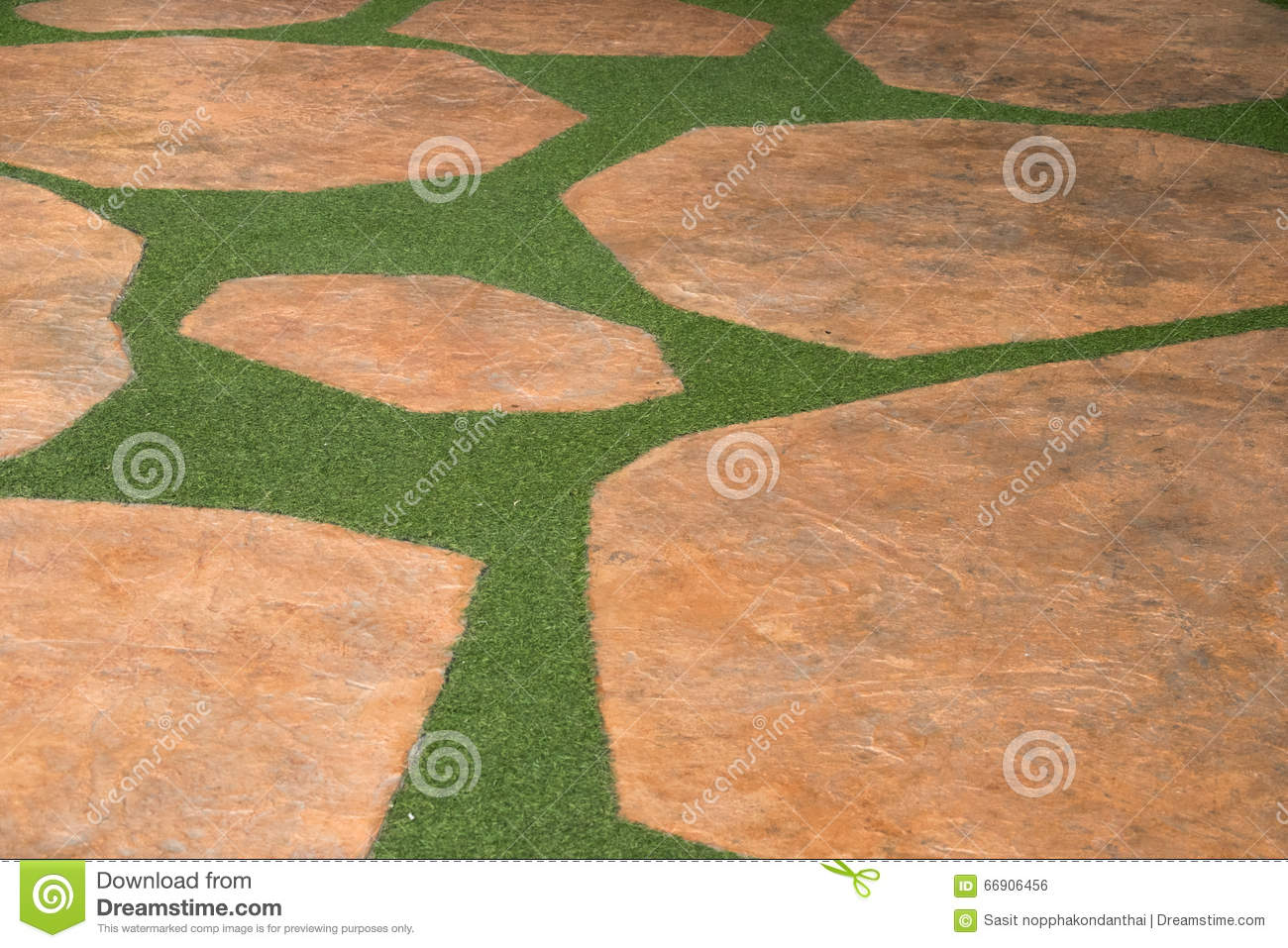 Brown stone and artificial turf grass pathway