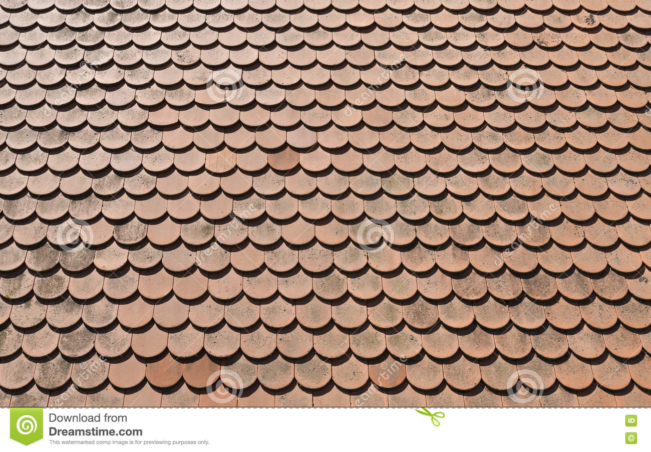 Brown Tile Roof In Sunny Day As Background Stock Photo