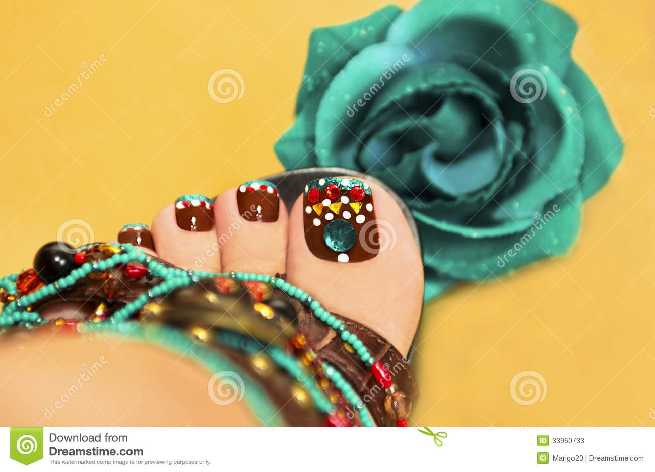 Beautiful art nail design women's feet in sandals with a rose on a ...