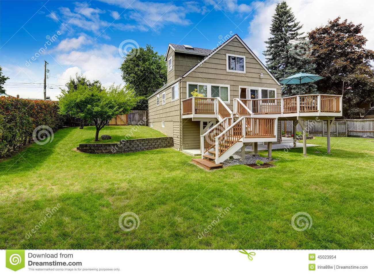 Cozy living room with fireplace - Big House With Walkout Deck In Brown And White Trim Spacious Backyard