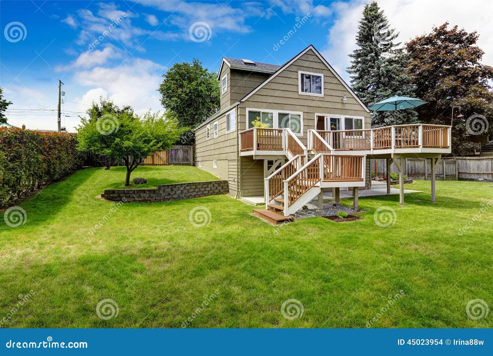 Brown Walkout Deck With White Trim Backyard View Stock
