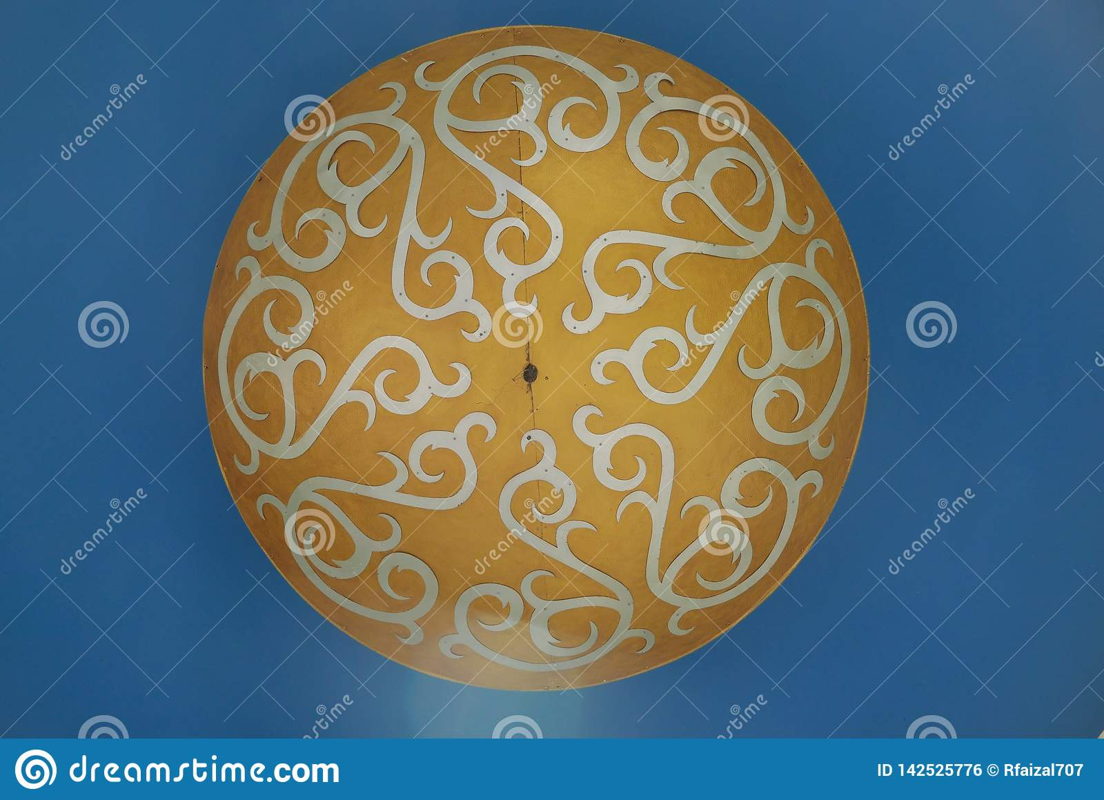 Brown,white and blue ceiling ornamented