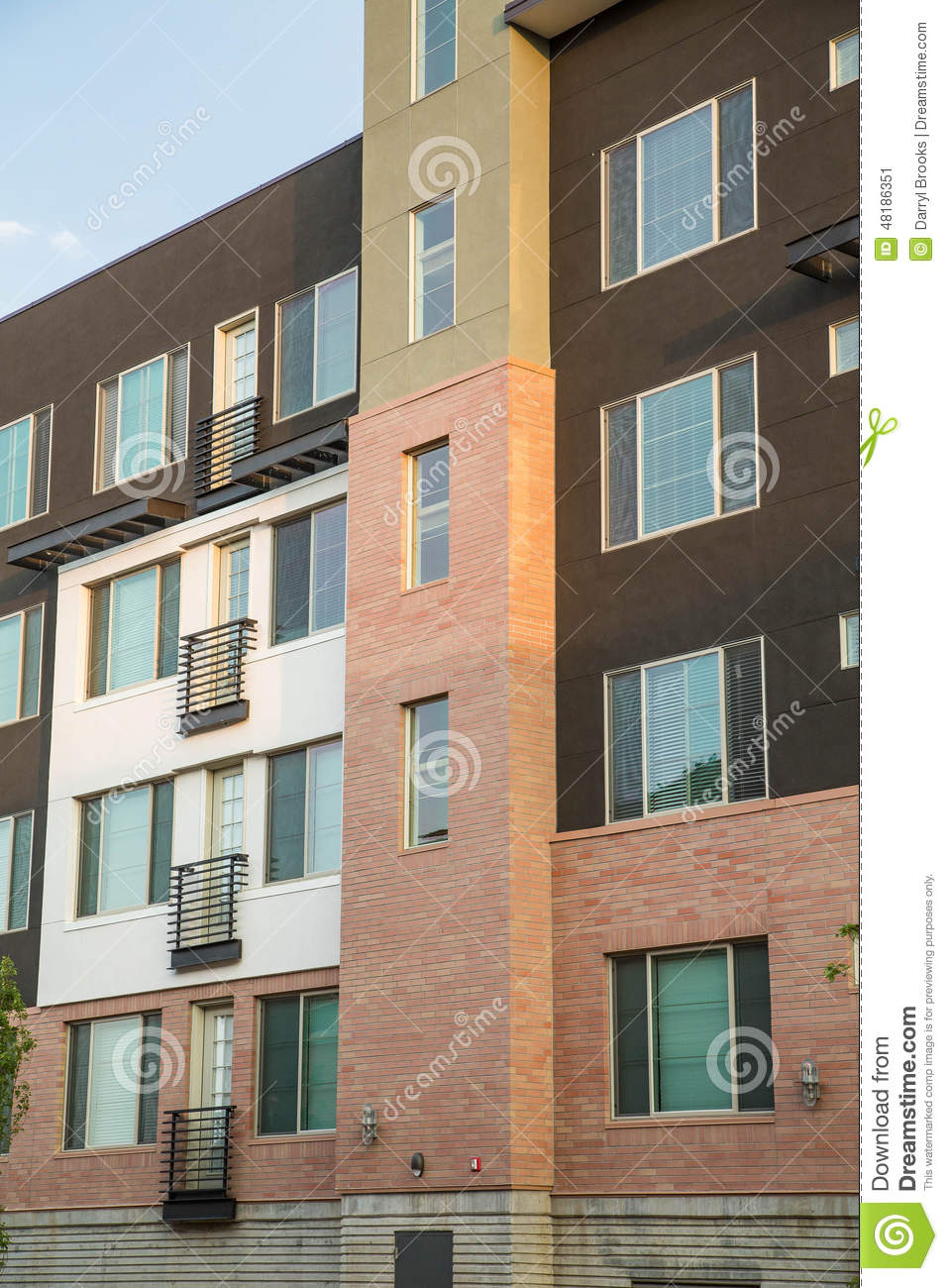 brown white and red apartment building stock photo image
