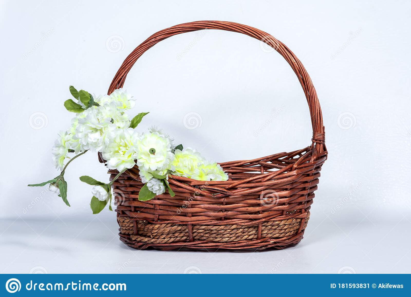 Brown Wicker Basket With Flower Arrangements On The Handle Of The Basket Stock Image Image Of Color Flowers 181593831