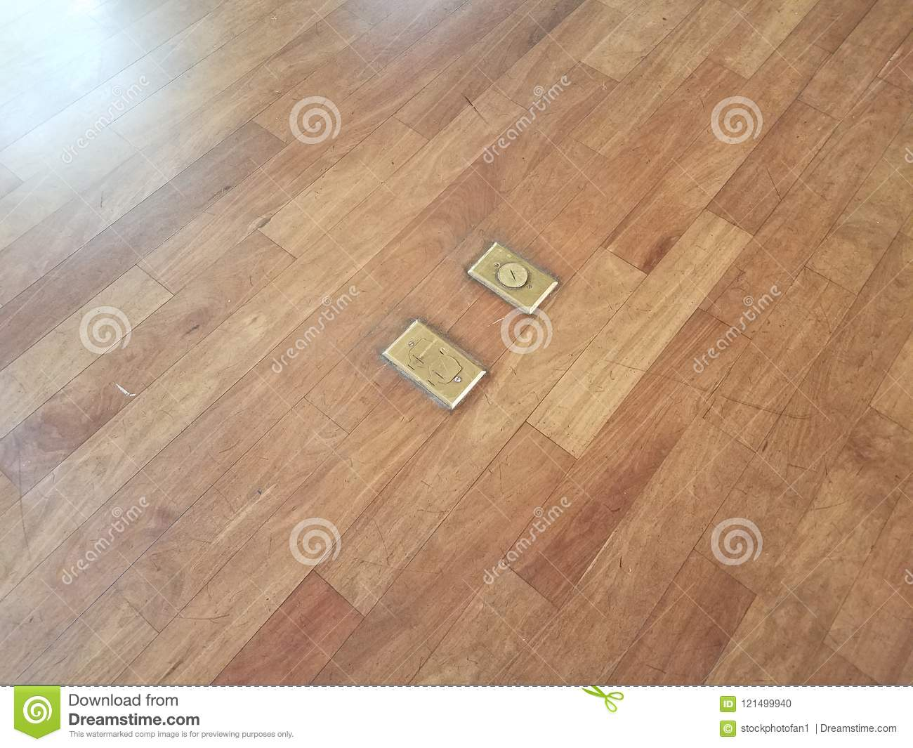 Brown Wood Floor With Electrical Outlets Stock Photo - Image of