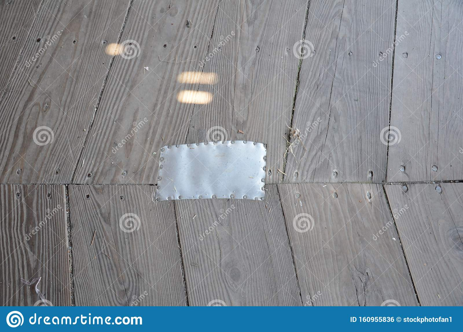 Brown Wood Floor With Metal Rectangle To Repair Hole Stock Photo Image Of Patched Repair 160955836