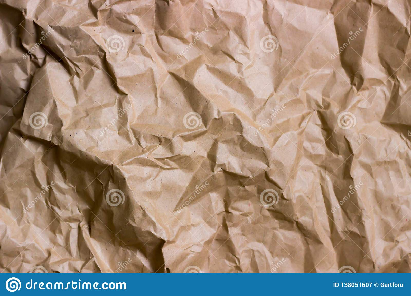 Brown wrinkle recycle paper background. Texture of crumpled paper. Texture of rumpled old paper close-up