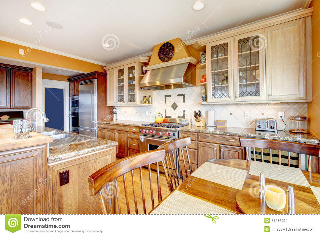 brown and yellow kitchen with dining table set stock images image