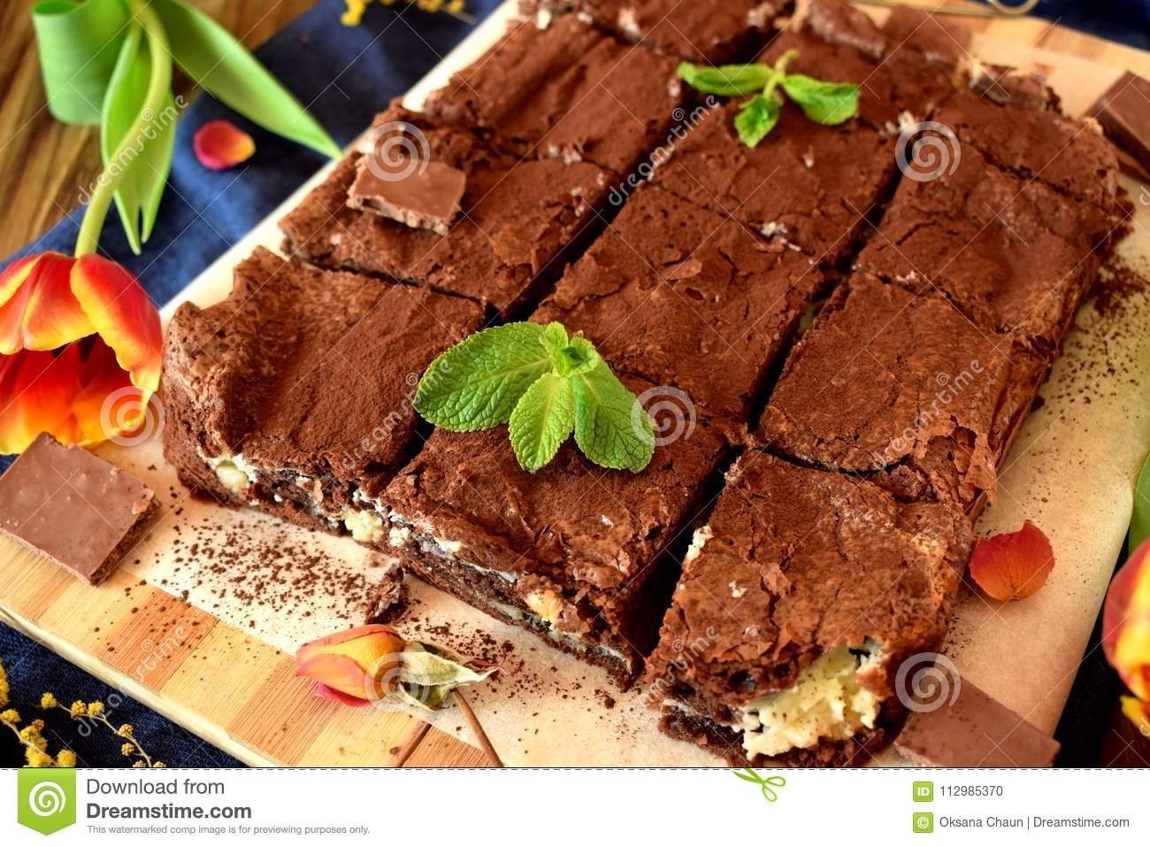 Brownie square pieces covered with cacao powder