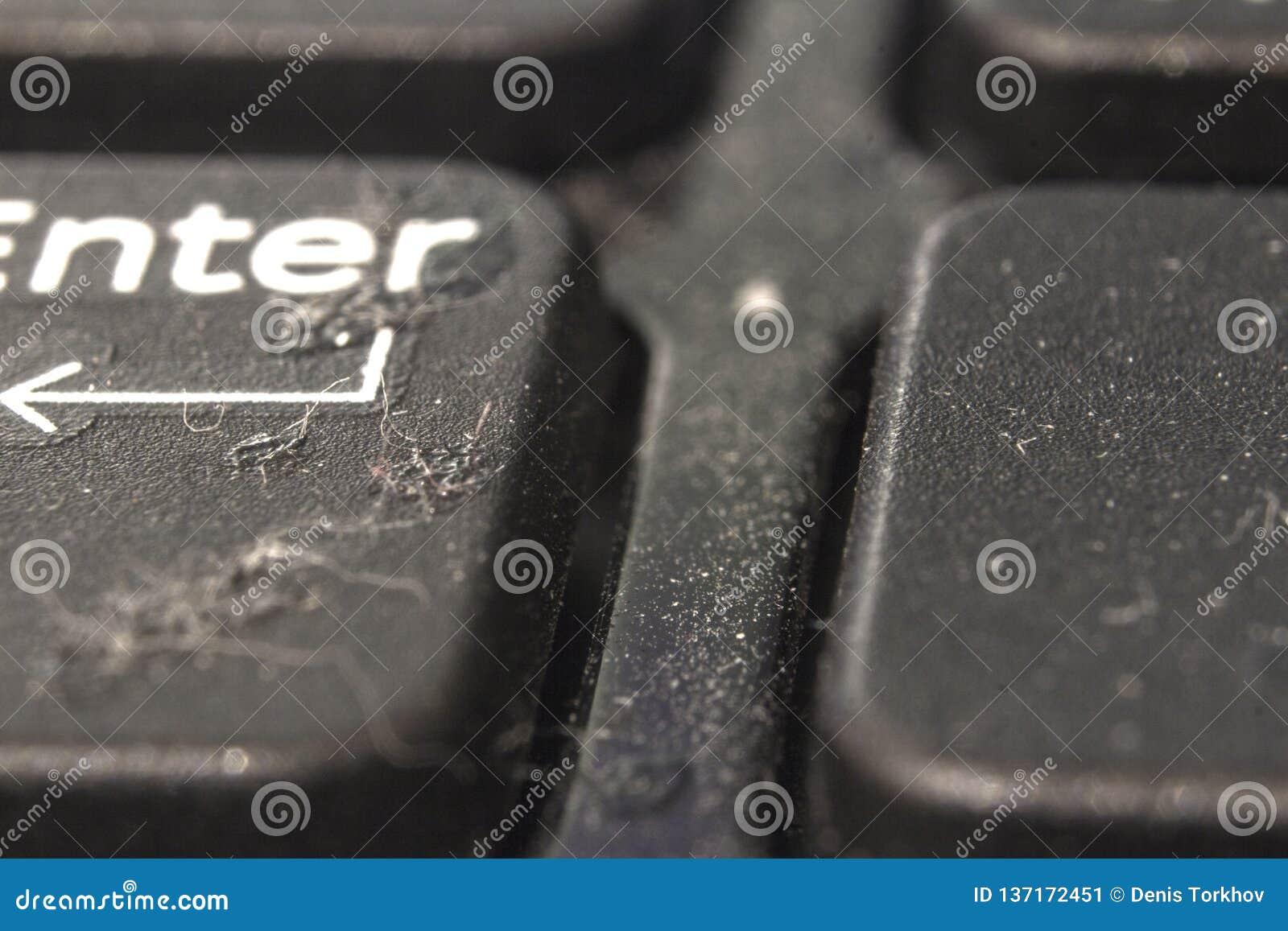 Brud i pył na laptopów guzikach Zakończenie plecy i przedpole zamazujemy