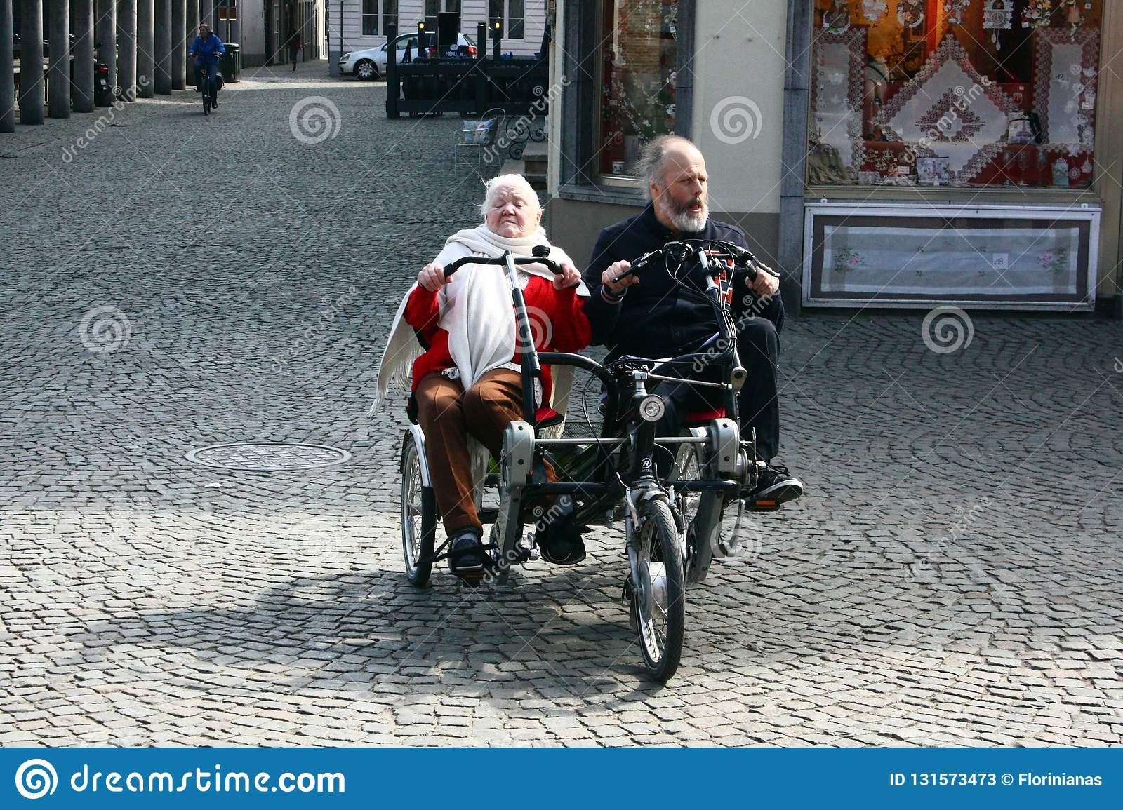 BRUGES, BELGIUM- 03  26 2018 Elderly Couple Tourists Ride A Side By