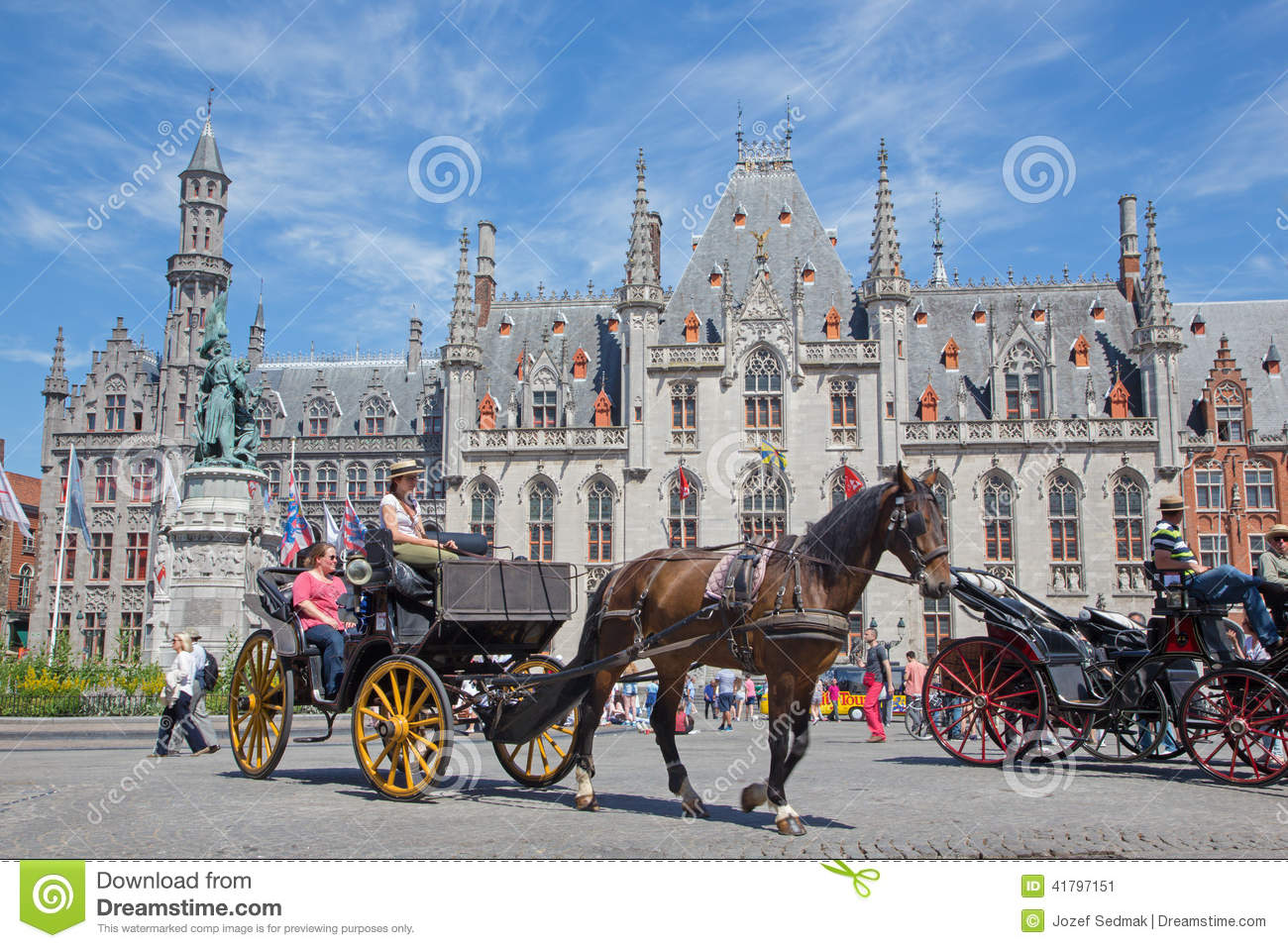 Bruges - The Carriage on the Grote Markt and the Provinciaal Hof building in background.