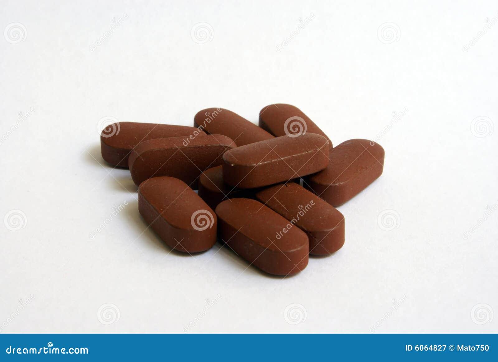 Bruine pillen stock afbeelding. Afbeelding bestaande uit ...