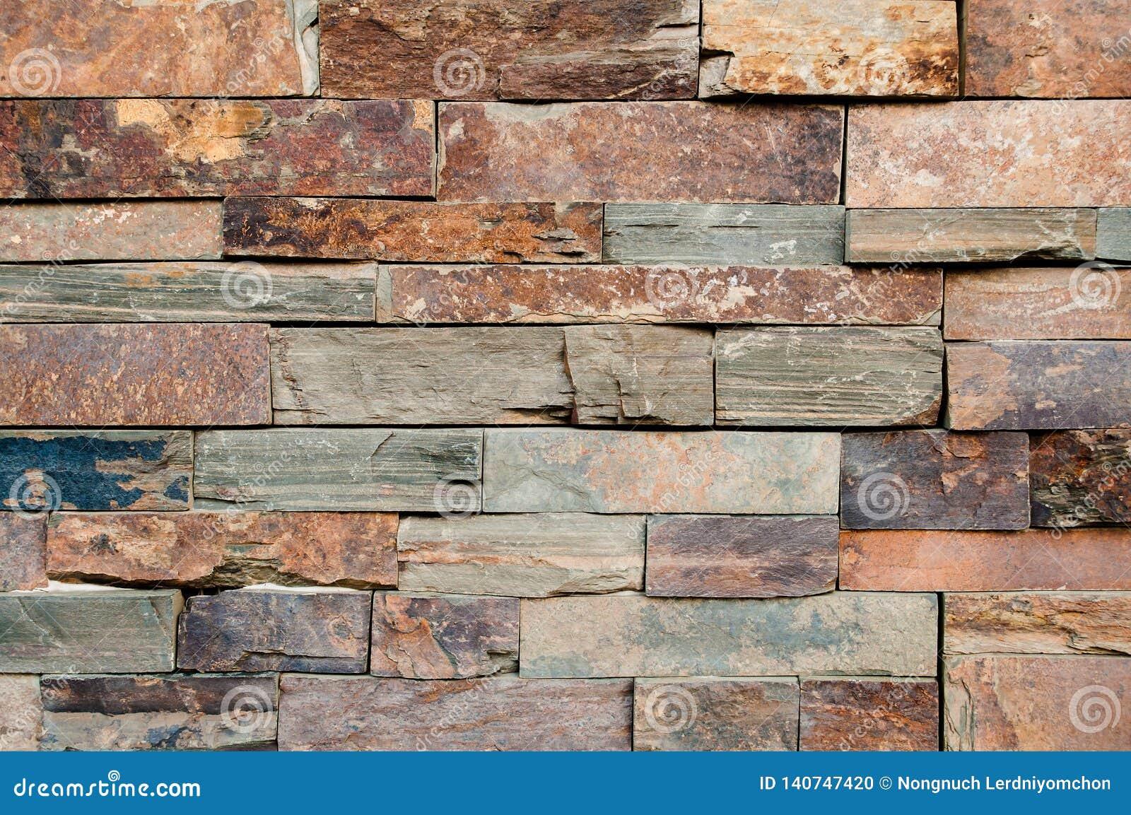 Brun Grunge, beige, apelsin, grå bakgrund för textur för tegelplattor för stenvägg Marmorerar den smutsiga naturliga bruna stenen