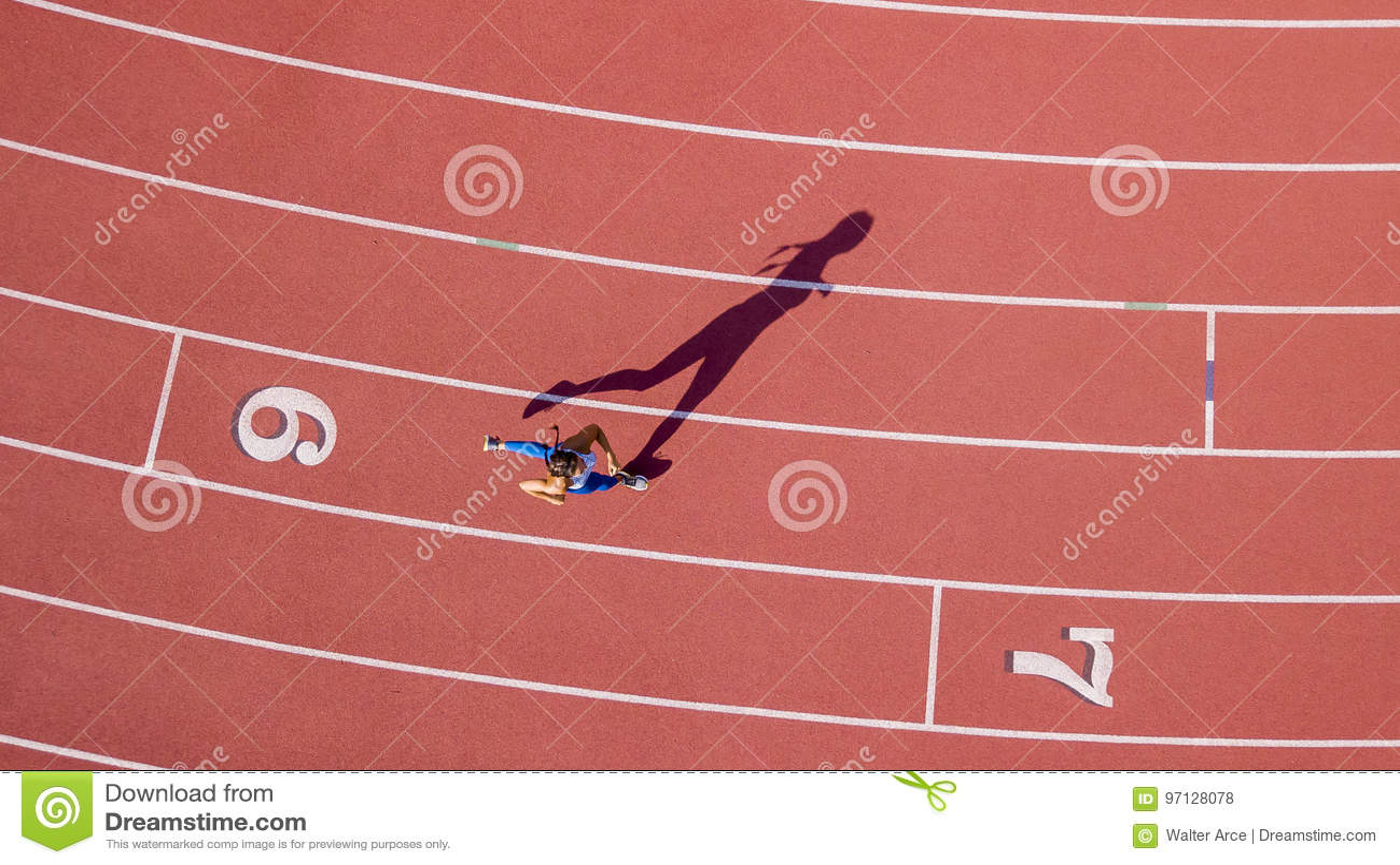 Brunette Fitness Model Running On A Track