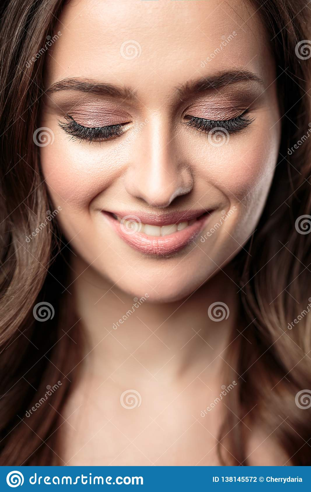 Brunette Girl With Healthy Curly Hair And Natural Make Up