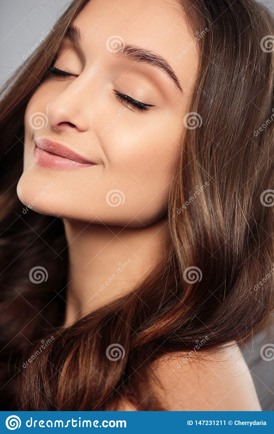Blonde Girl With Long And Shiny Wavy Hair . Beautiful