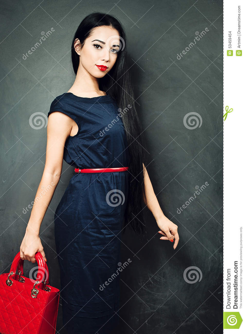 Black dress with red bag - Brunette Girl Wearing A Blue Dress And A Red Bag
