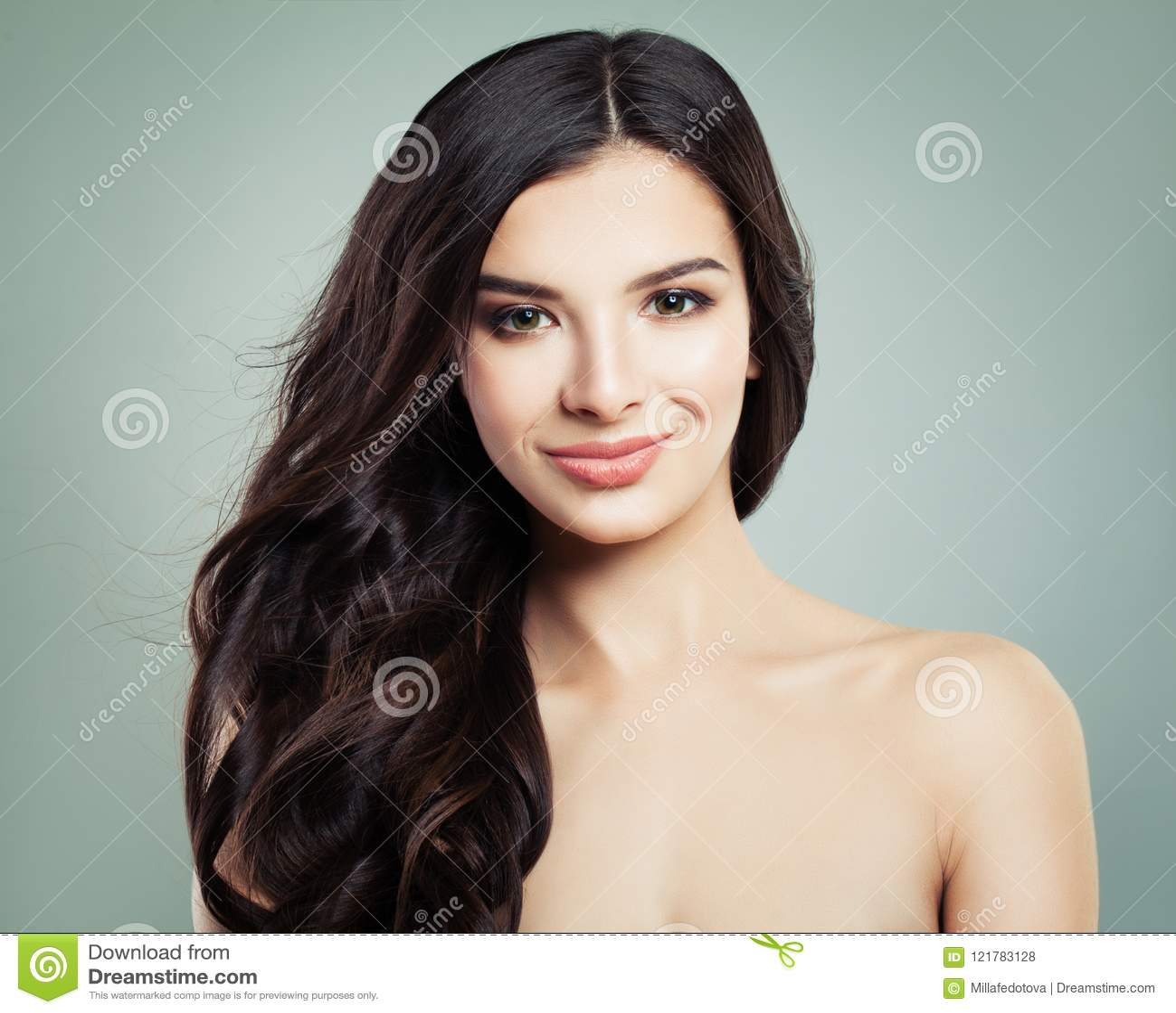 Brunette Hair Woman Smiling. Natural Makeup and Long Hair