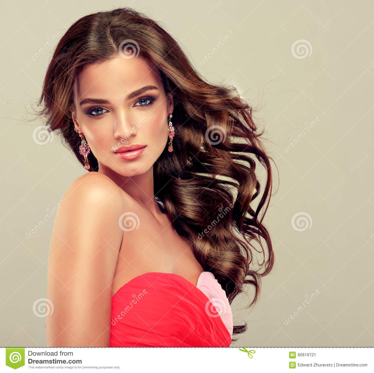 Brunette with long curled hair.