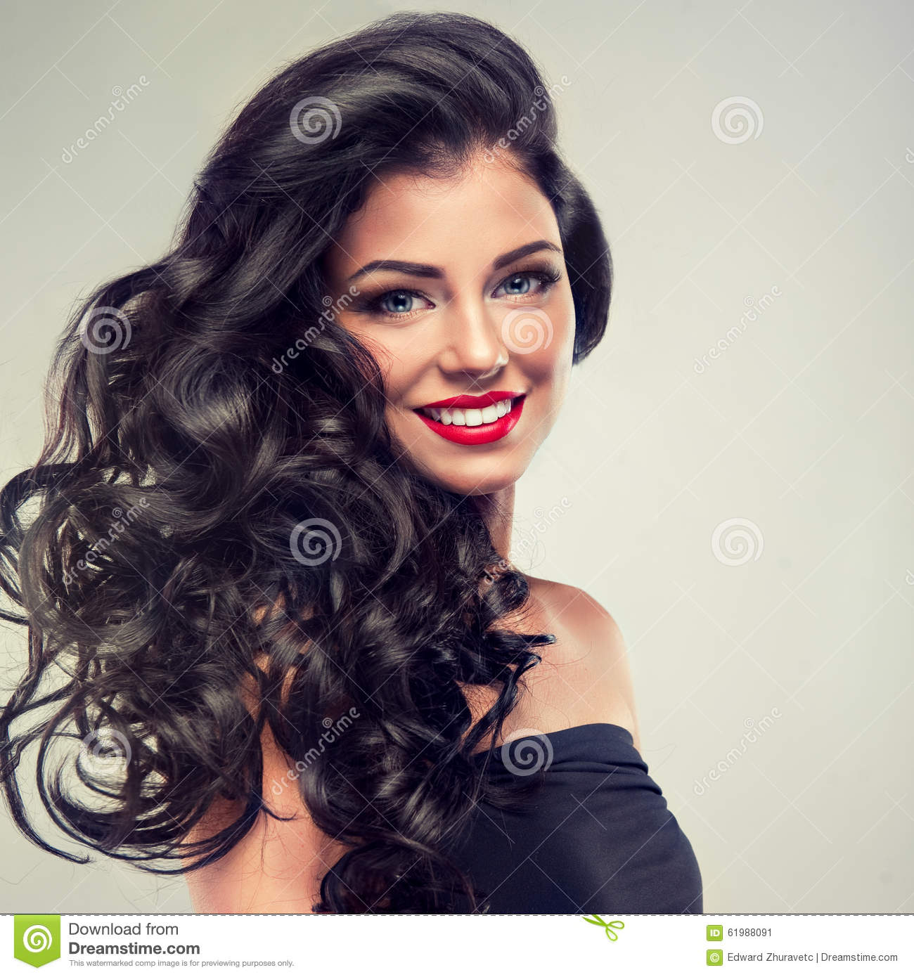 Brunette with long,dense curly hair.