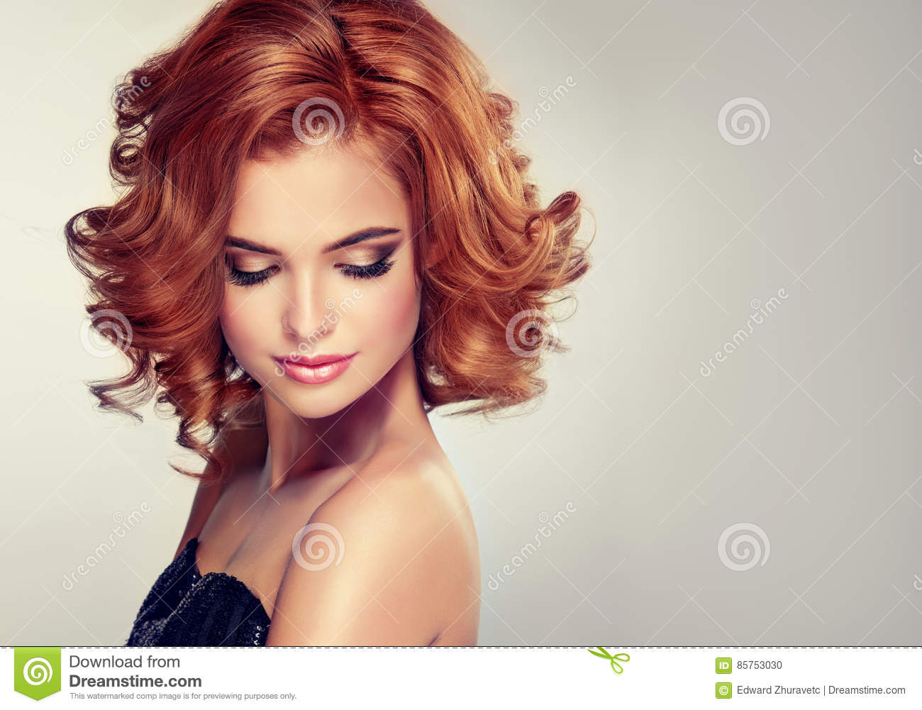 Brunette with middle length curled hair and bright make up.