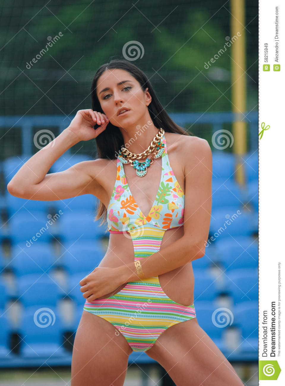 Brunette Model In A Swimsuit With Flash Tattos And