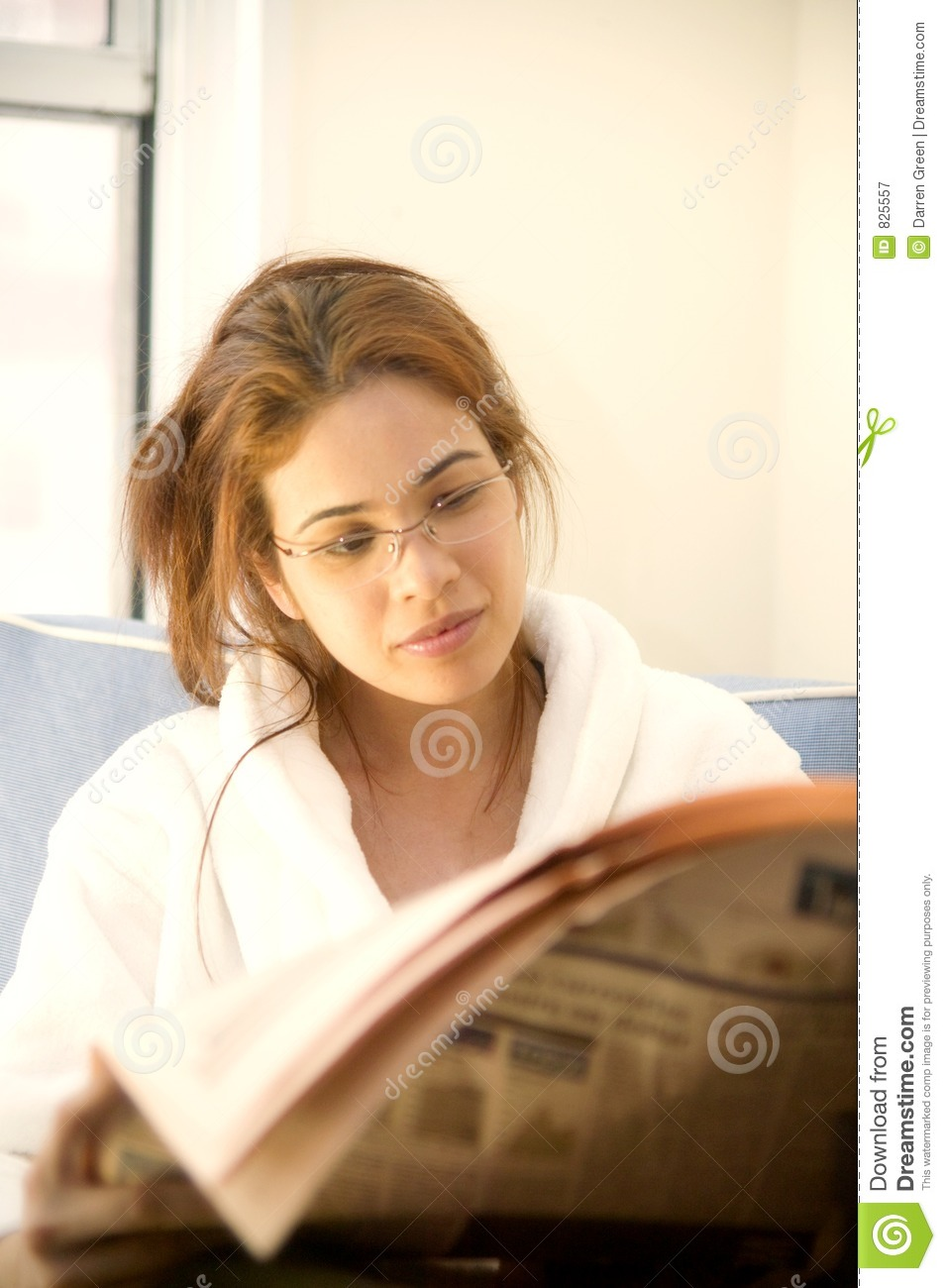 Brunette reading the morning papers