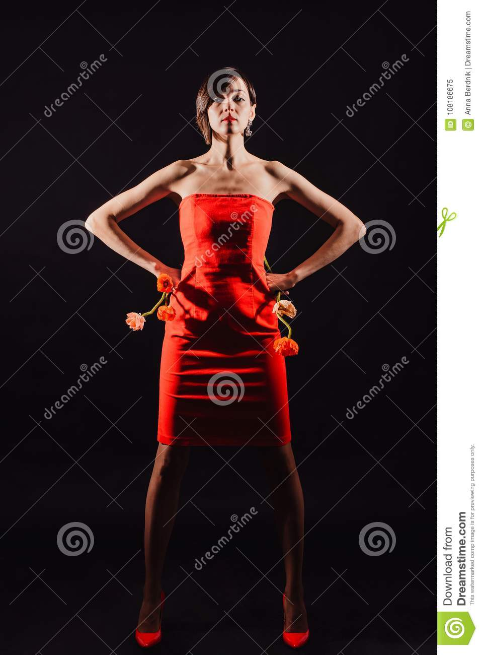 Brunette in a red dress with flowers on a black background
