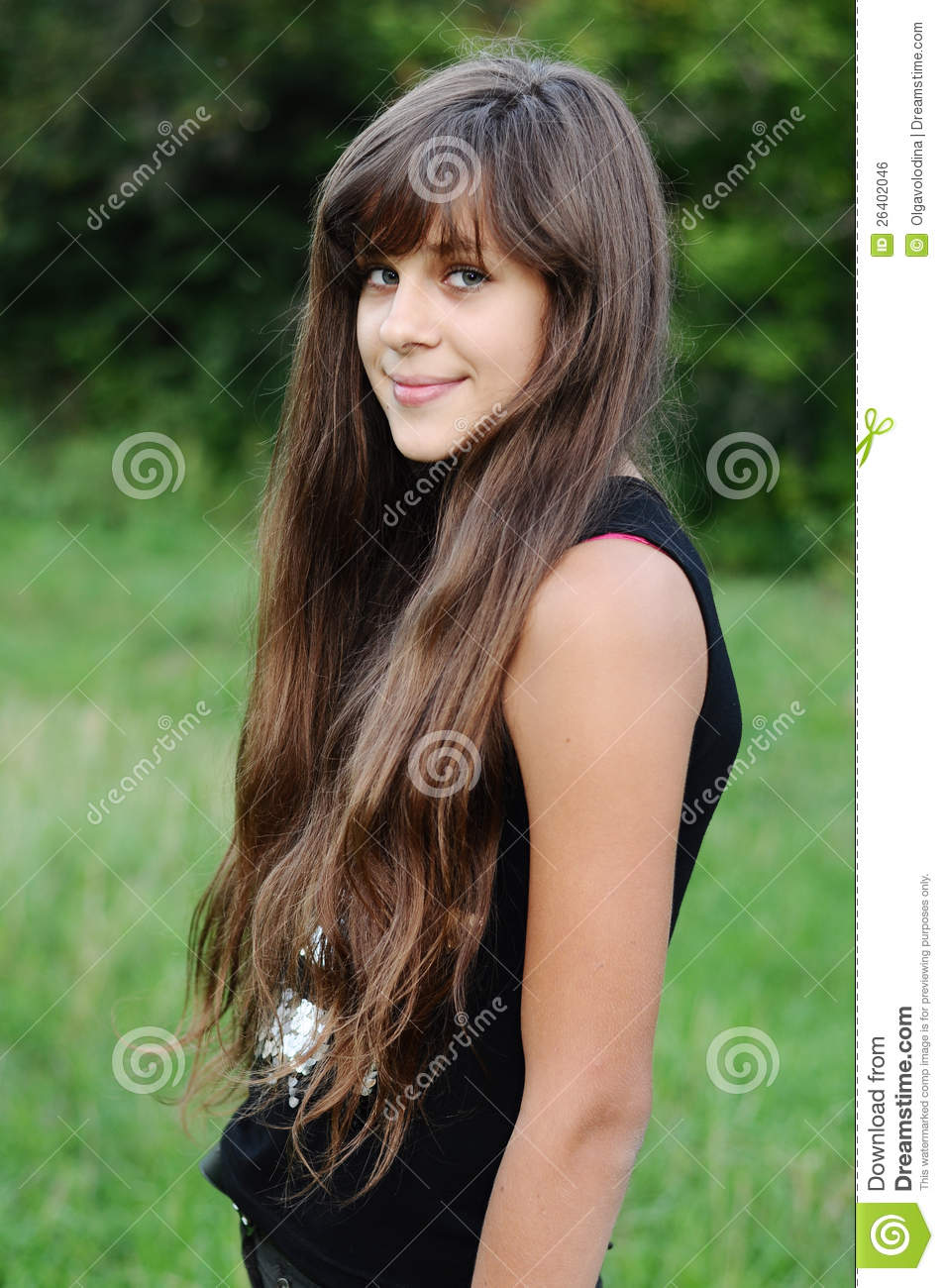 Brunette Teen Girl On Nature Stock Photo