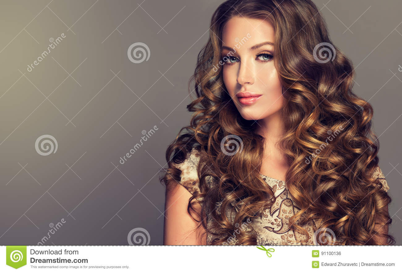 Brunette With Voluminous Shiny And Curly Hairstyle Stock