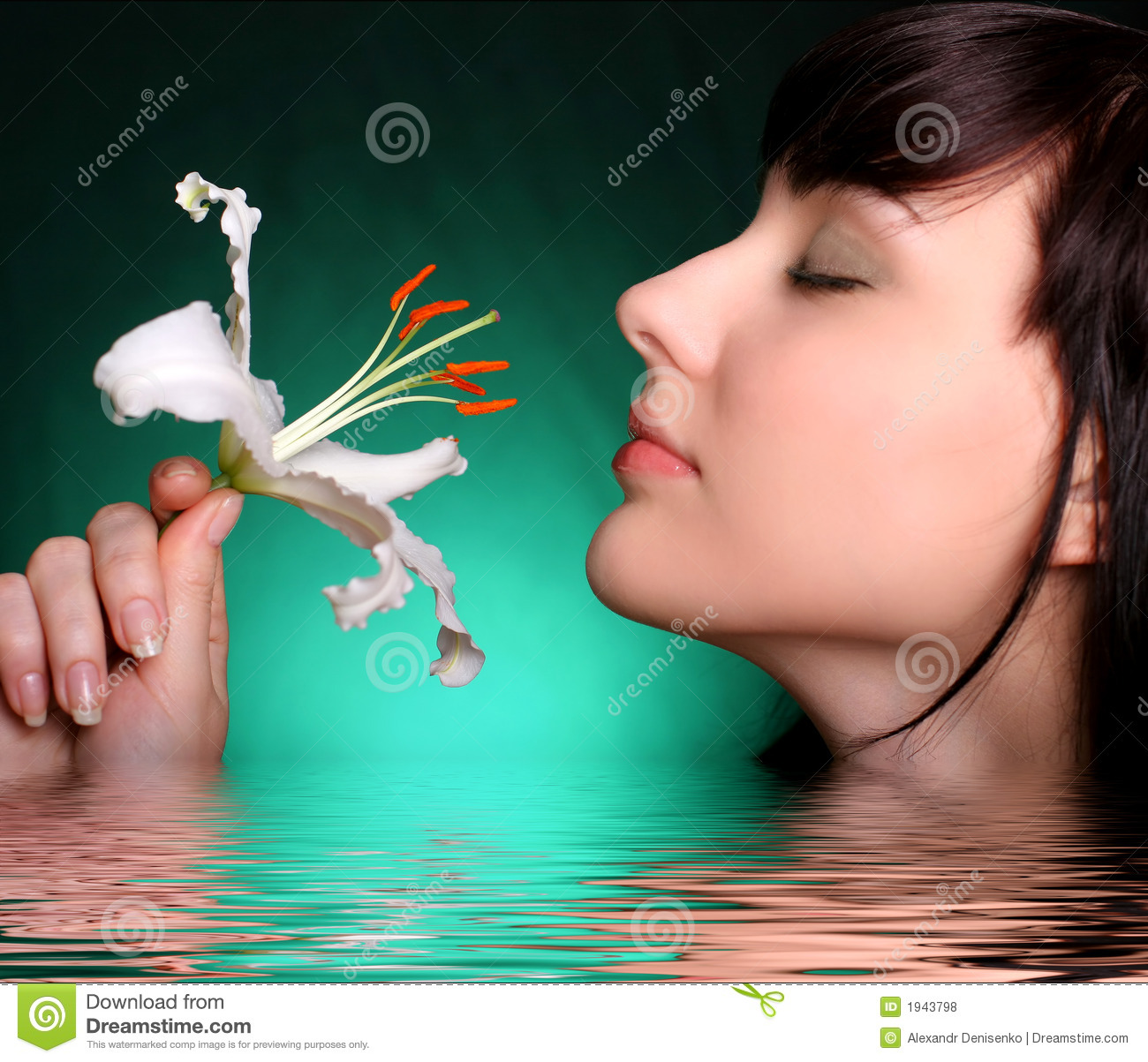 Brunette with white lily flowers in water
