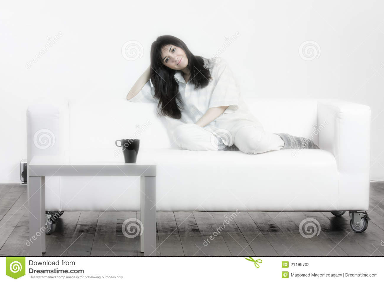 Brunette woman on couch