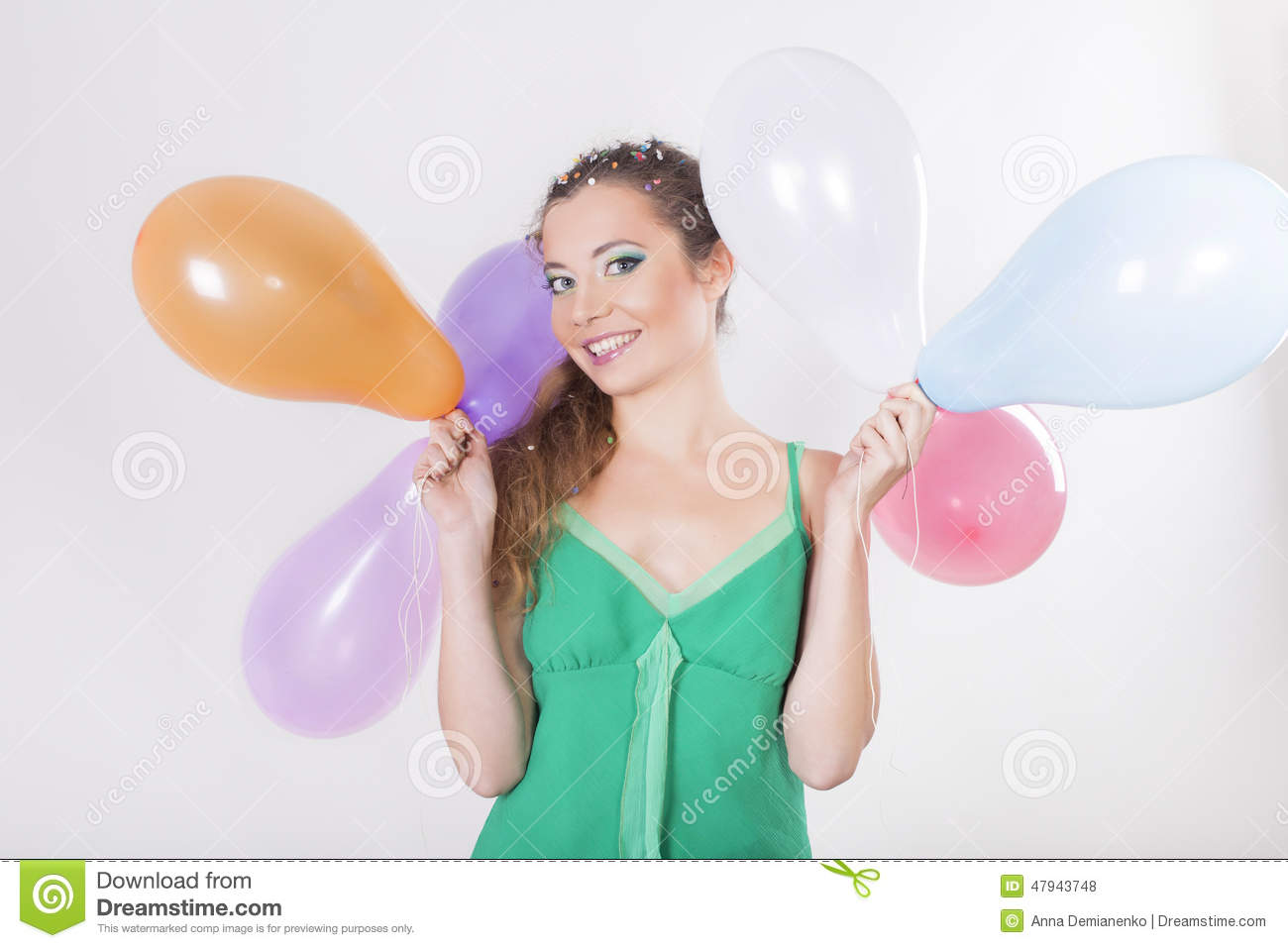 Brunette Woman Holding Balloons On Her Birthday Party