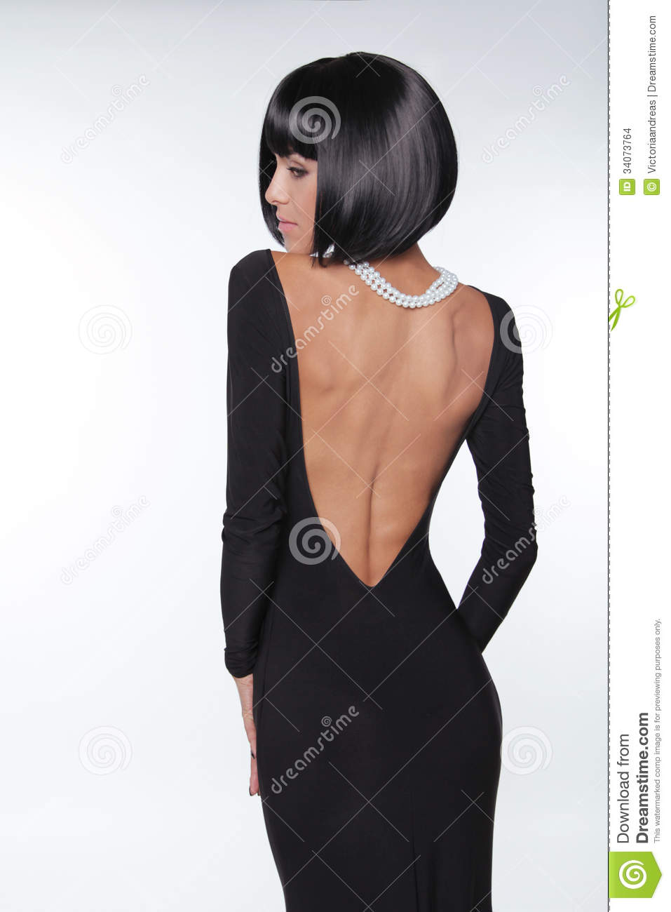 Brunette Woman With Back In Black Dress Stock Images