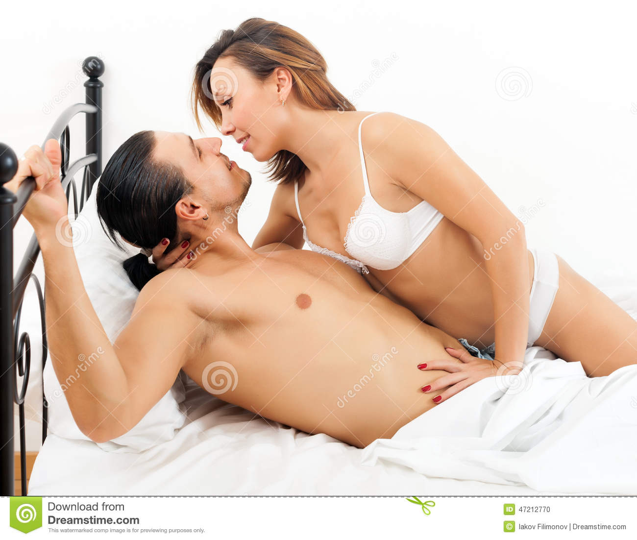 Women having sex in the bed