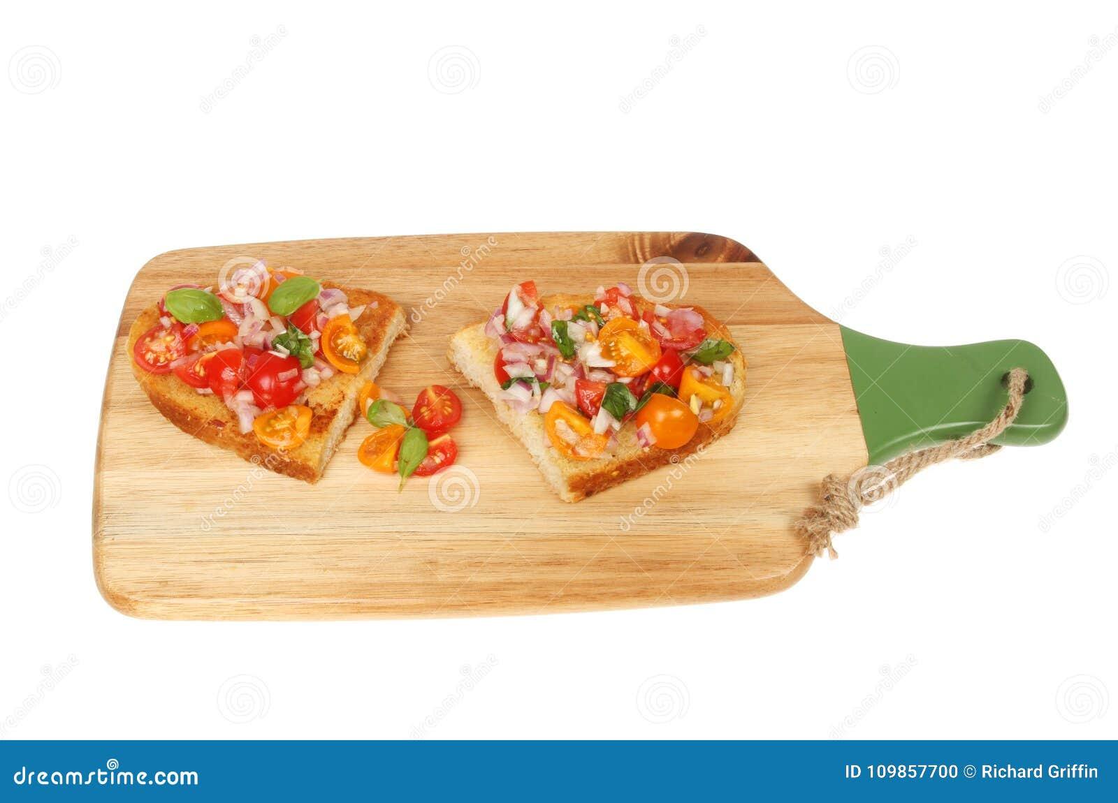 Bruschetta on a chopping board