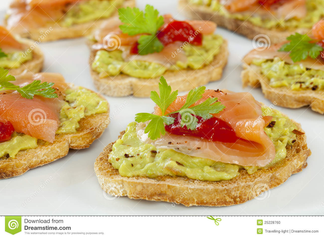Crostini or bruschetta with guacamole, smoked salmon and fire roasted ...