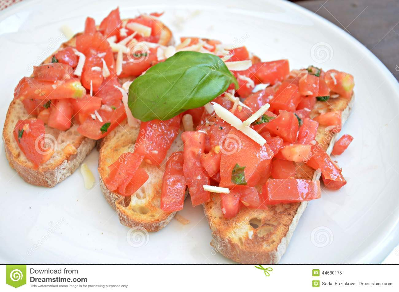 Bruschette with tomato, cheese and basil