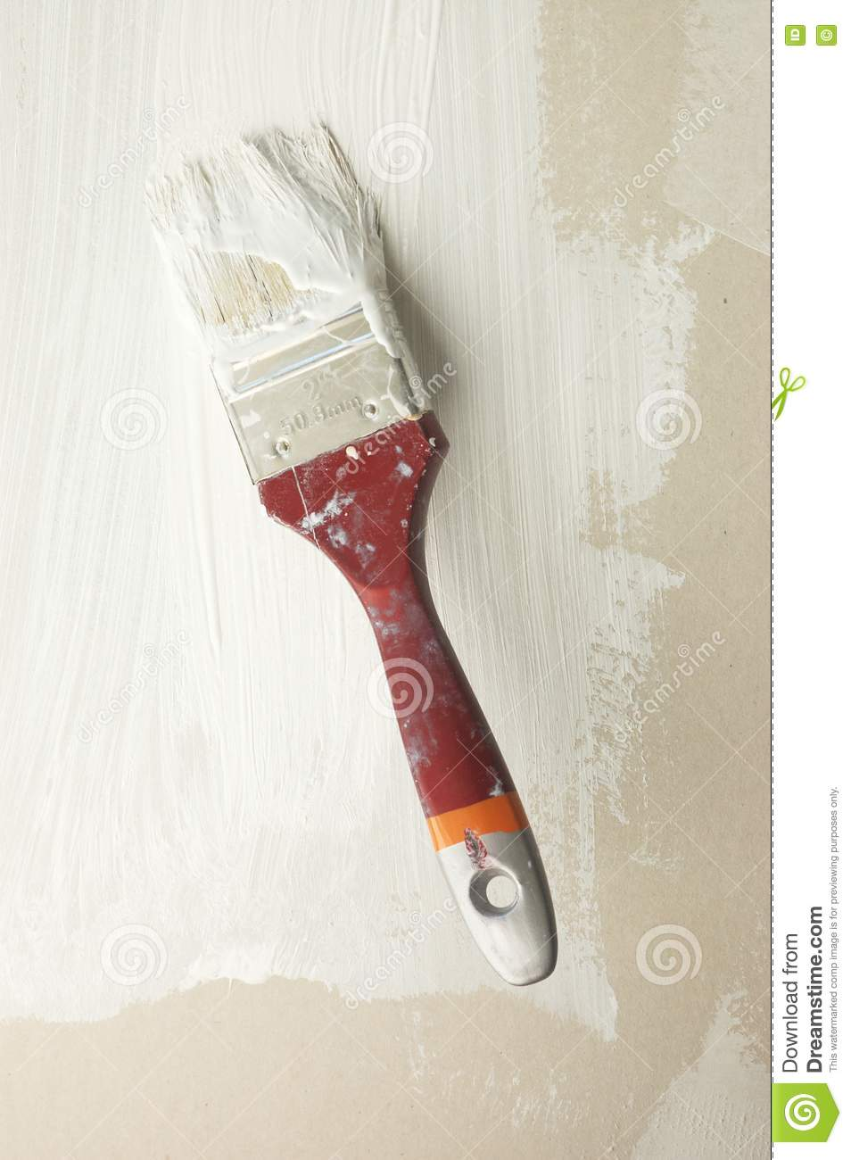 Wall Design Paint Brush : Brush in white paint on wall stock photography image
