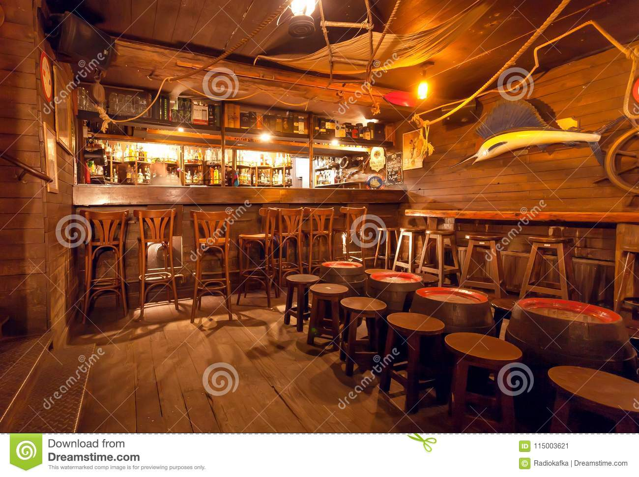 Interior Of Retro Style Bar With Old Wooden Furniture