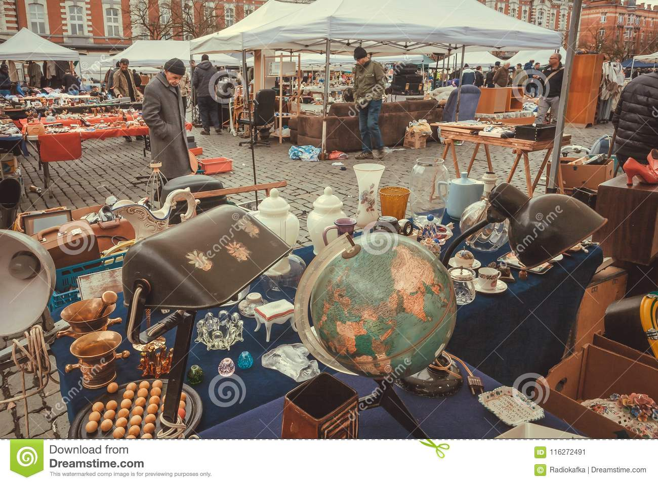 Street traders on flea market with old art, bargains and antique stuff, vintage decor and retro details