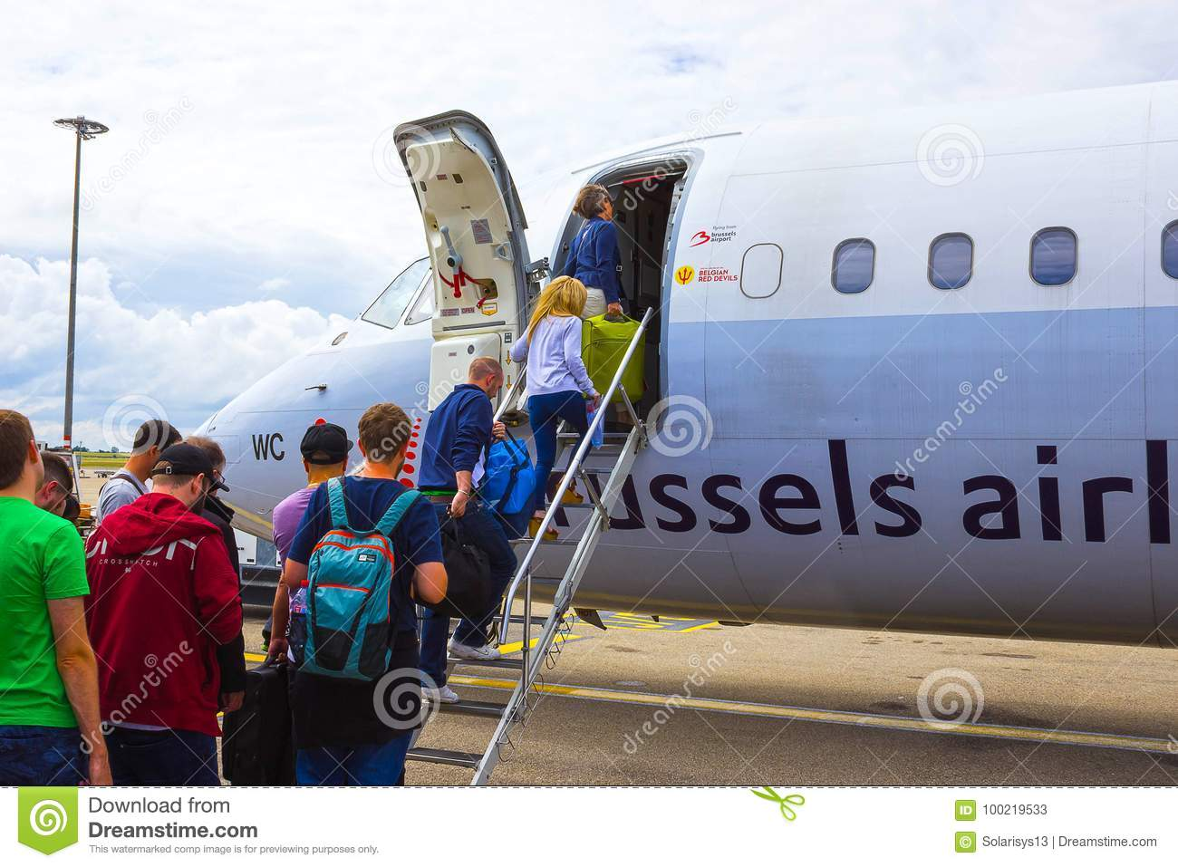 Brussels, Belgium - June 19, 2016: The people boarding the Brussels Airline aircraft. Passenger walking to the rear