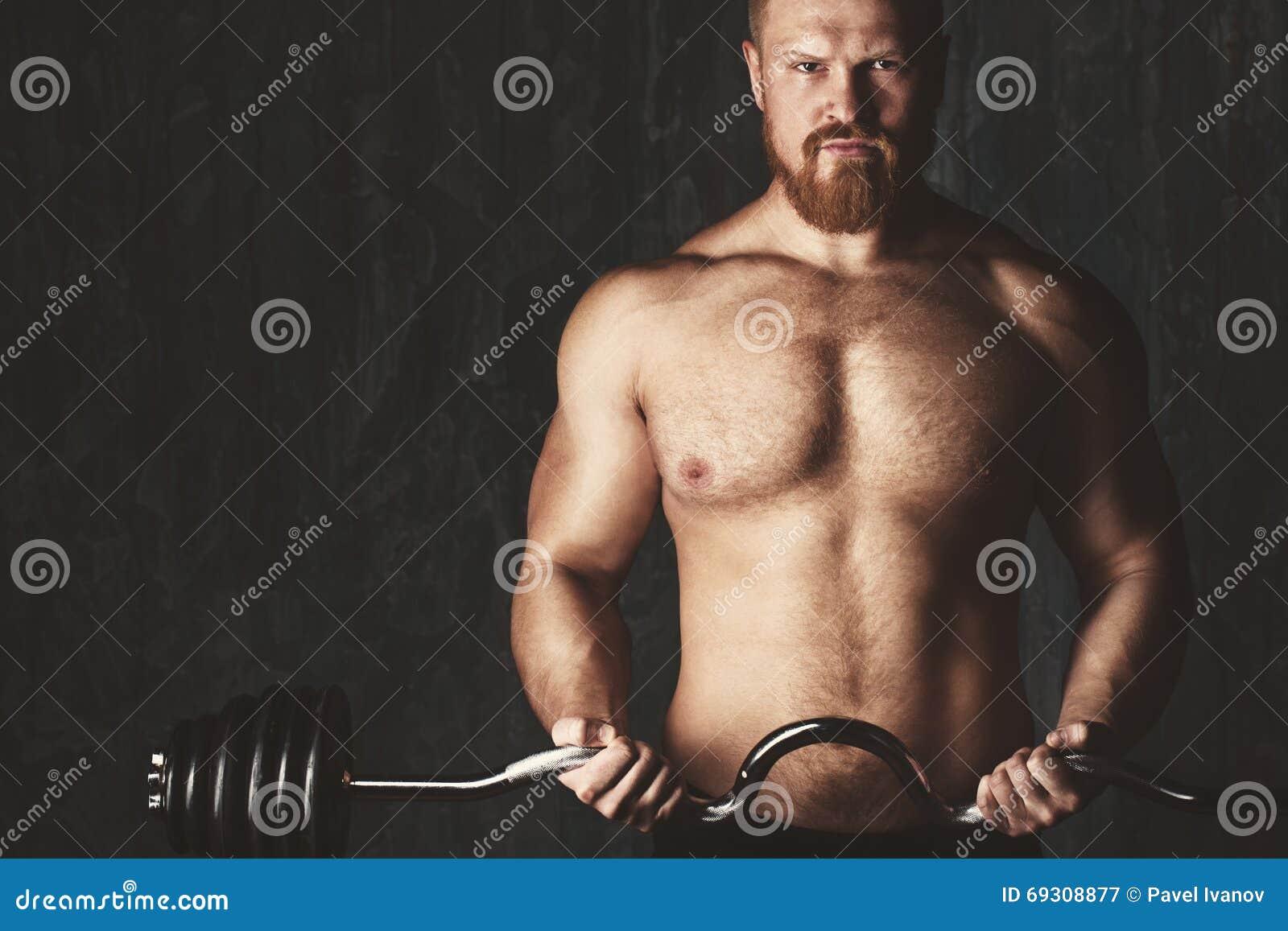 Brutal bodybuilder. Deadlift barbells workout.