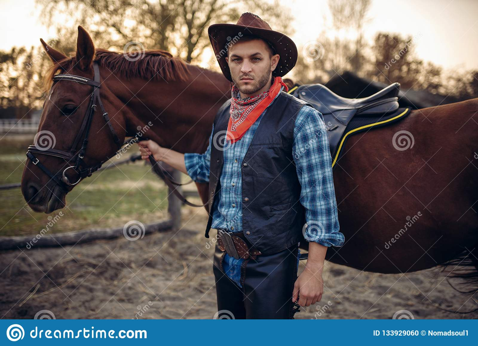 Brutal Cowboy Poses With Horse Wild West Stock Photo Image Of Retro Horse 133929060