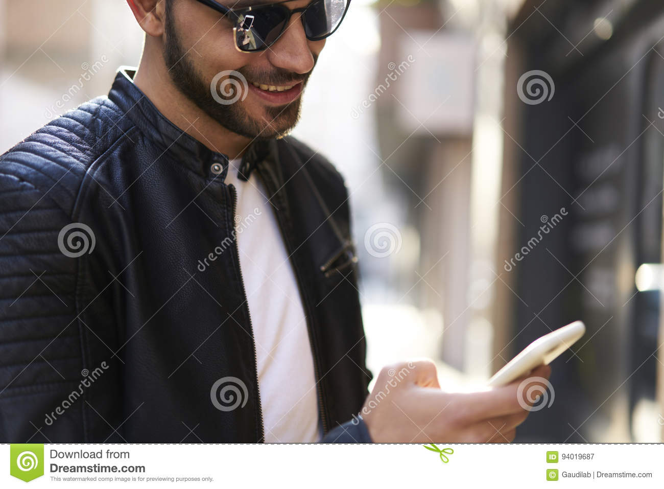Brutal guy in a leather jacket and sunglasses