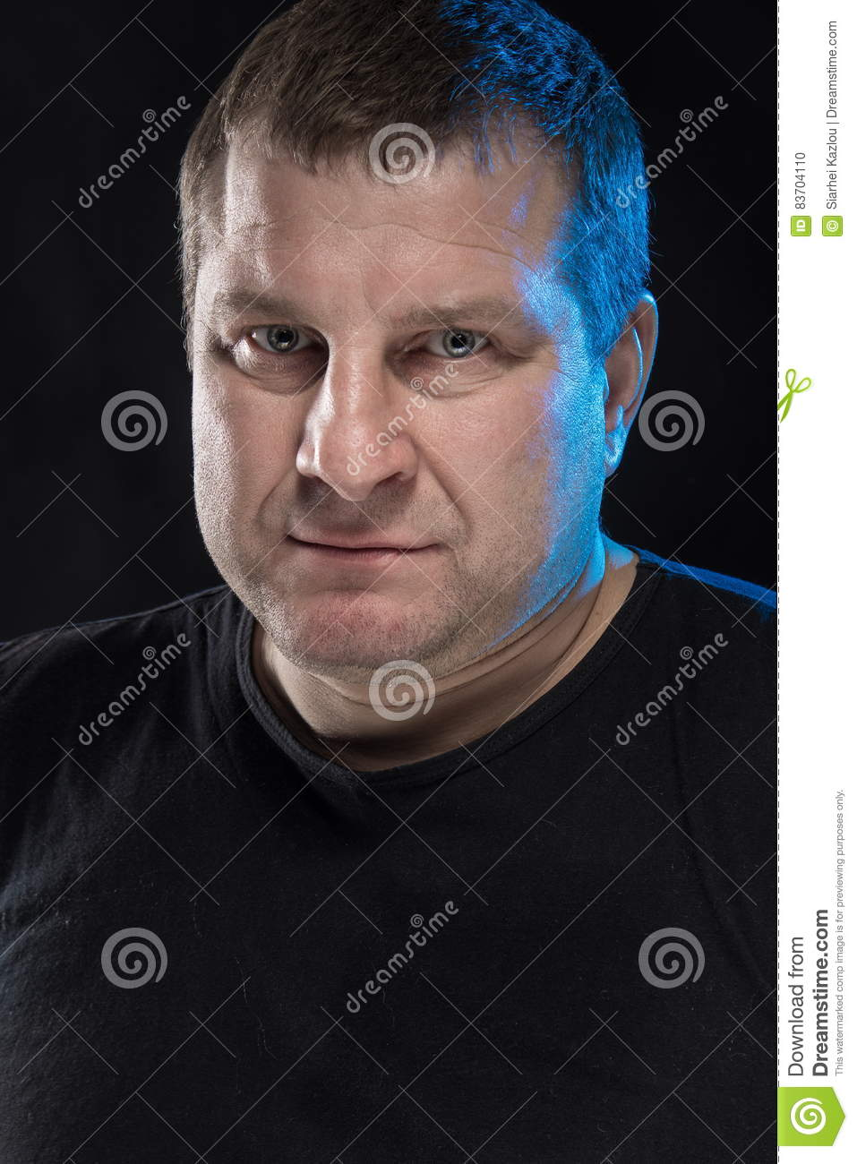 Brutal Man Actor Gesticulates And Grimaces. Stock Photo